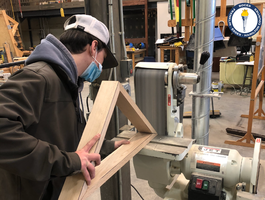 Building Trades student builds meaningful box with teacher's help